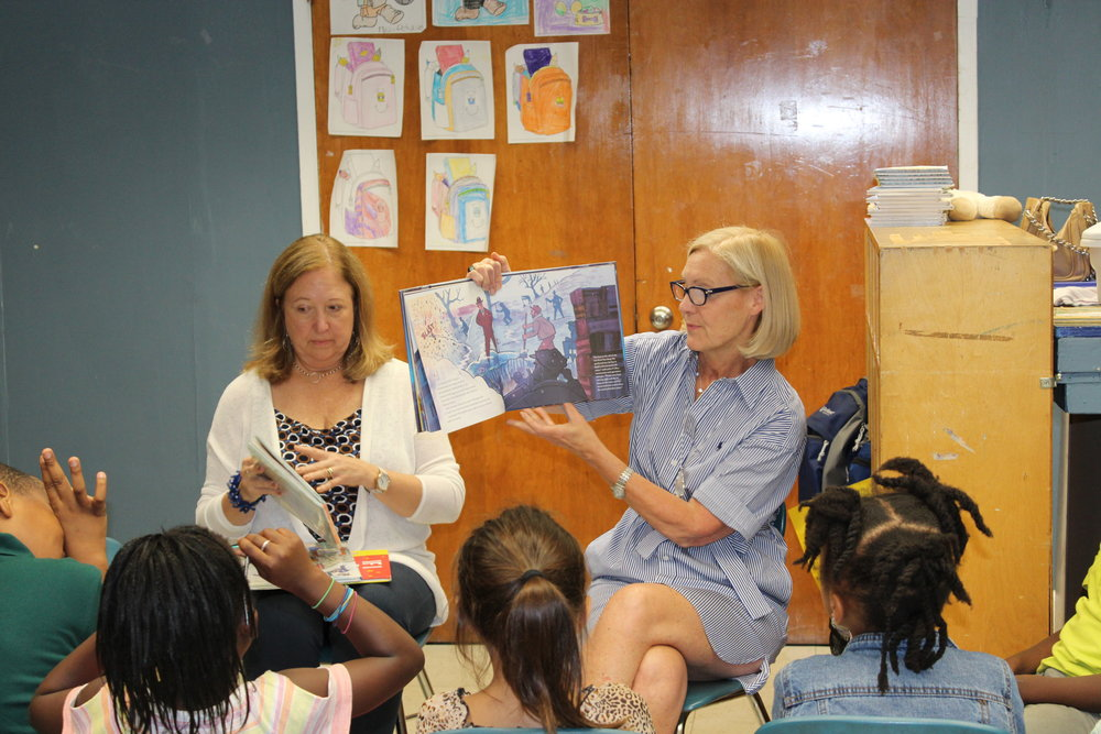Betsy Kelley Evans (R) and Meri Erickson read to Carver kids