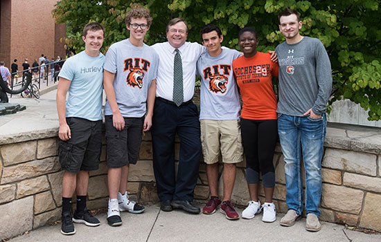 Five RIT/NTID students were named the university's first Maguire Scholars. Pictured, from left to right, are Ethan Misal, Nathan Murray, RIT/NTID President Gerry Buckley, Cameron Carey, Trinity McFadden and Ty Brady. Photo credit:  A. Sue Weisler