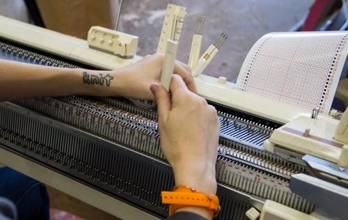 Degen knitting at her knitting machine