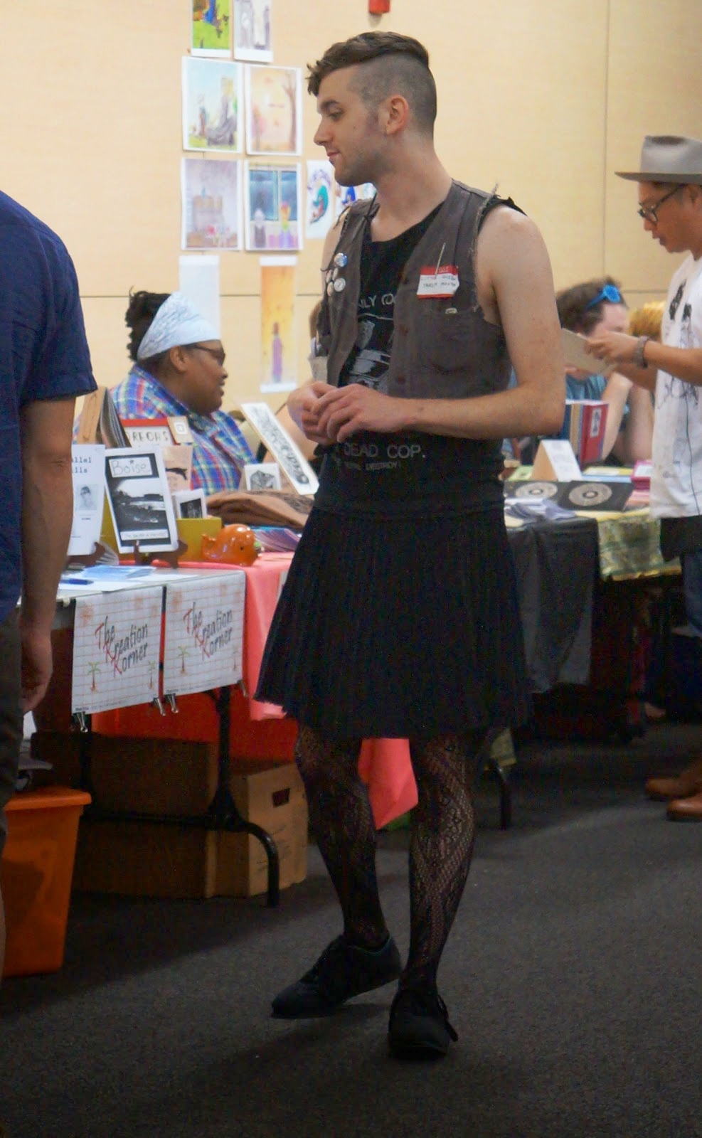 This bloke rocked a punk meets school teacher appeal with a tattered tee, pleated skirt, and lacy tights.