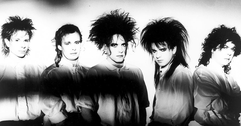 The Cure, below Robert Smith