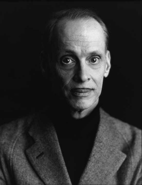 John Waters owning the 'pencil mustache'.
