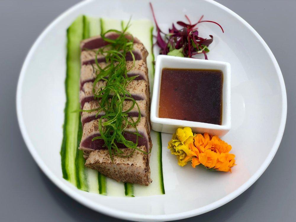 SUSHI (continued) - — Samurai Roll* — shrimp tempura, spicy tuna, jalapeno, Sriracha, spicy mayo, eel sauce$16— Orange Roll* — salmon, avocado, massago, scallions$14— Tuna Tatami Sashimi* —torched tuna, scallions, micro greens, tataki sauce$16— Sashimi Moriawase* (assortment) —chef's choice of four$18