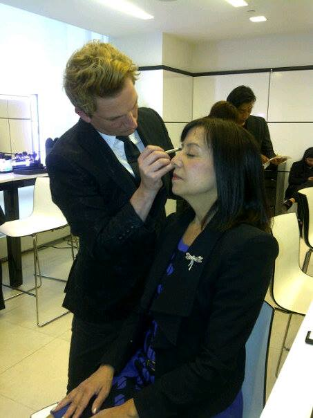 Adam applying Dianes makeup at CHANEL