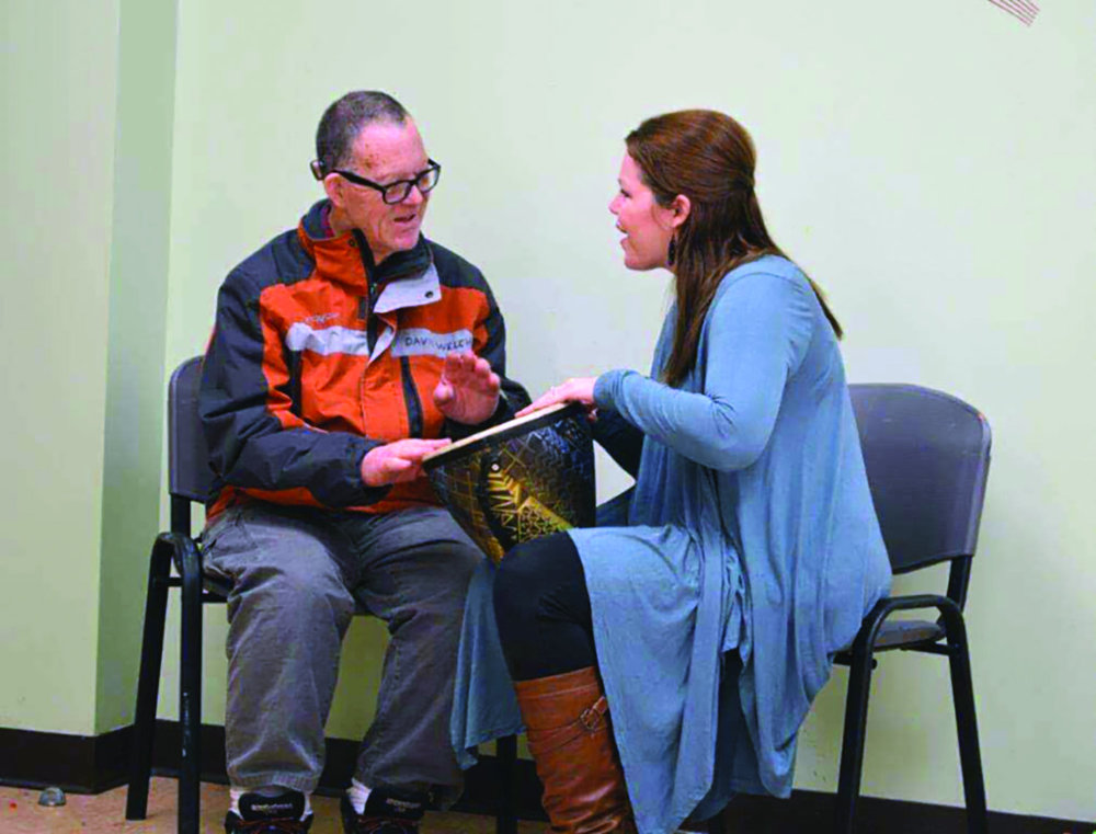 Music therapist, Jodie Ross, and former resident of The Baddour Center, David, during a therapy session. photo courtesy of The Baddour Center