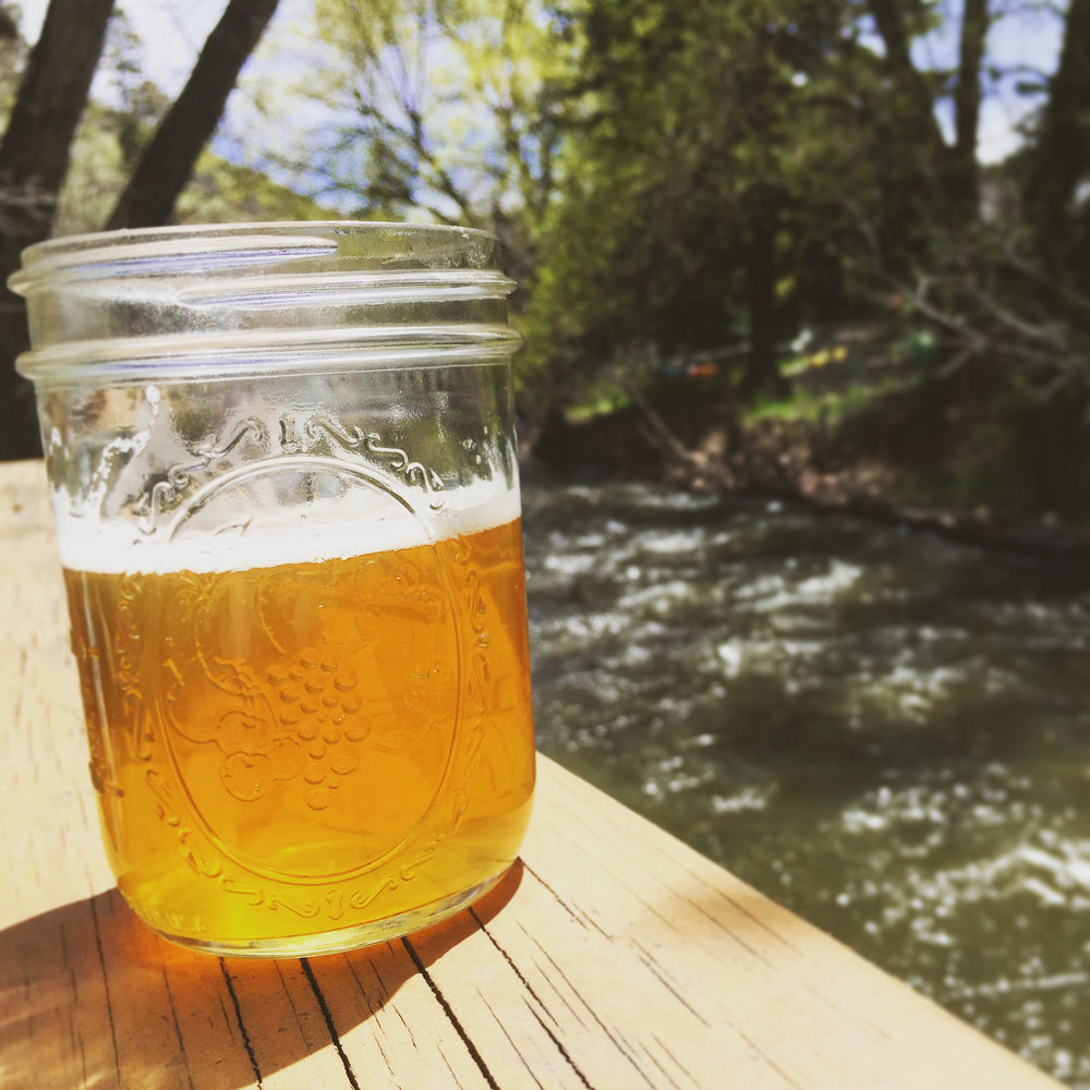 Enjoy a cold beer creekside at Switchback Smokehouse