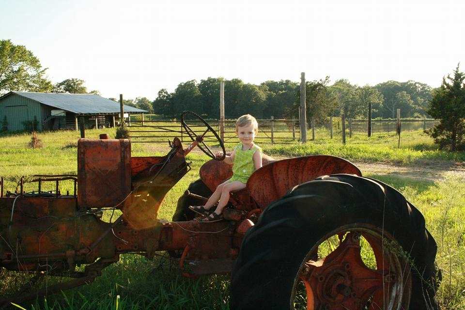Smiling for the camera on an antique tractor at White Bros. Farm; Photo by @nmassey444