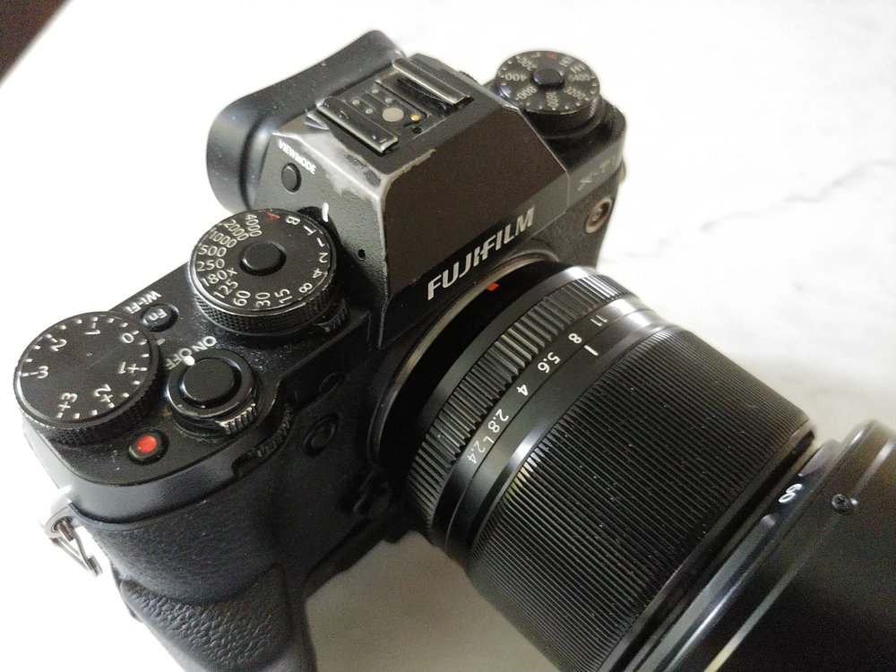 My well-loved Fuji X-T1, fitted with the XF 60mm F2.4 Macro lens has all of it's exposure controls mounted right on the body. You know where you're starting from without having to turn on the camera, and once you know the gear, those satisfying clicks eliminate the need to look at what you're doing. Shot on my LG v30 smartphone.