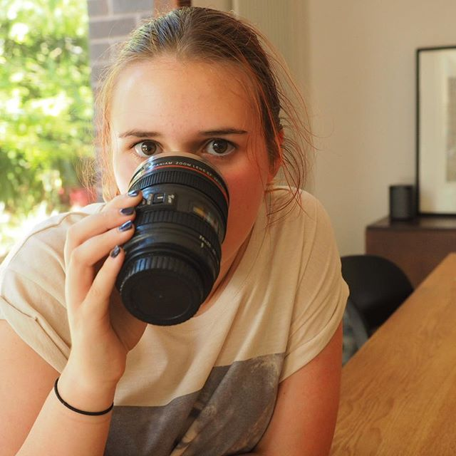 Lucy bought herself a camera lens mug!