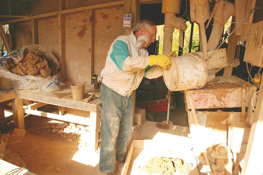 Bobby mixing clay