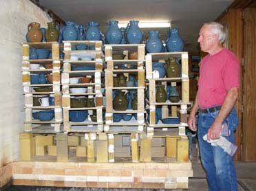 Bobby unloading kiln he has fired.