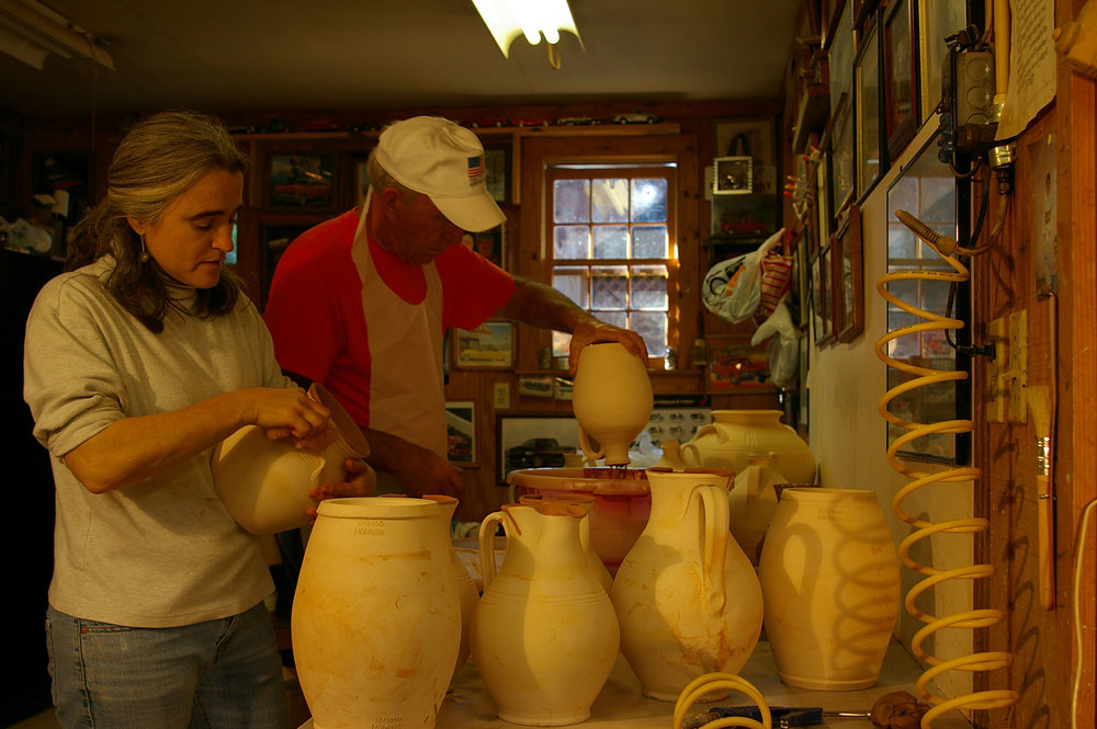Bobby and Pam working in the glaze room.