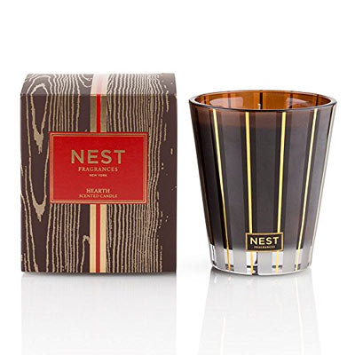 Nest Hearth Scented Candle - Rich oud wood with frankincense and hints of smoky embers.