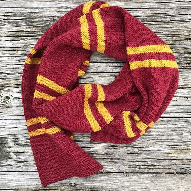 "So there are already like 70+ patterns on Ravelry for Hogwarts House scarves, but none of them were *just right* for the vision I had in my head. So I magicked up my own! In case your vision for a perfect Hogwarts scarf happens to align with mine, I have written up the pattern and published it for free on Ravelry: the ""Hoggy Warty Hogwarts Scarf."" Enjoy, fellow knitterly witches. 🧙🏻‍♀️🧣✨ Link in profile. . . . . . . . #knittersofinstagram #harrypotterknits #harrypotterknitting #mollyweasleyismyhero #gryffindor #harrypotterscarf #hogwartscarf #harrypottercosplay"