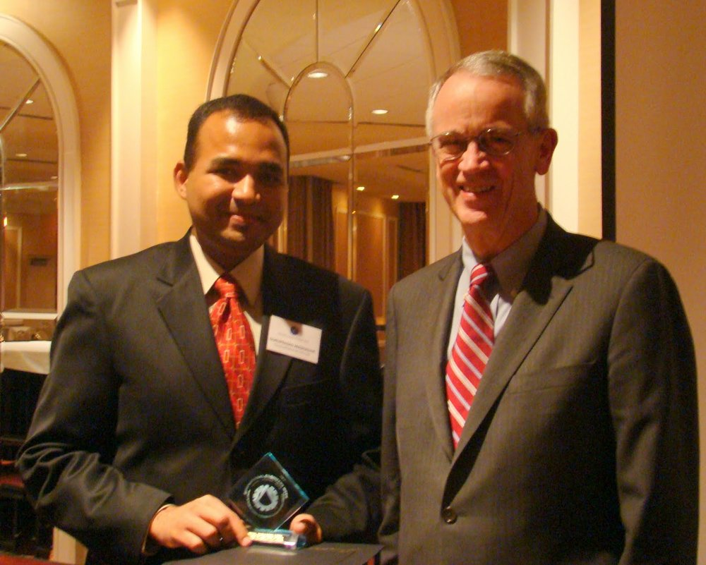 """In 2010, with Charles Vest, then president of the National Academy of Engineering and president-emeritus of MIT and the District of Columbia Council of Engineering and Architectural Societies' """"Young Engineer of the Year Award"""""""