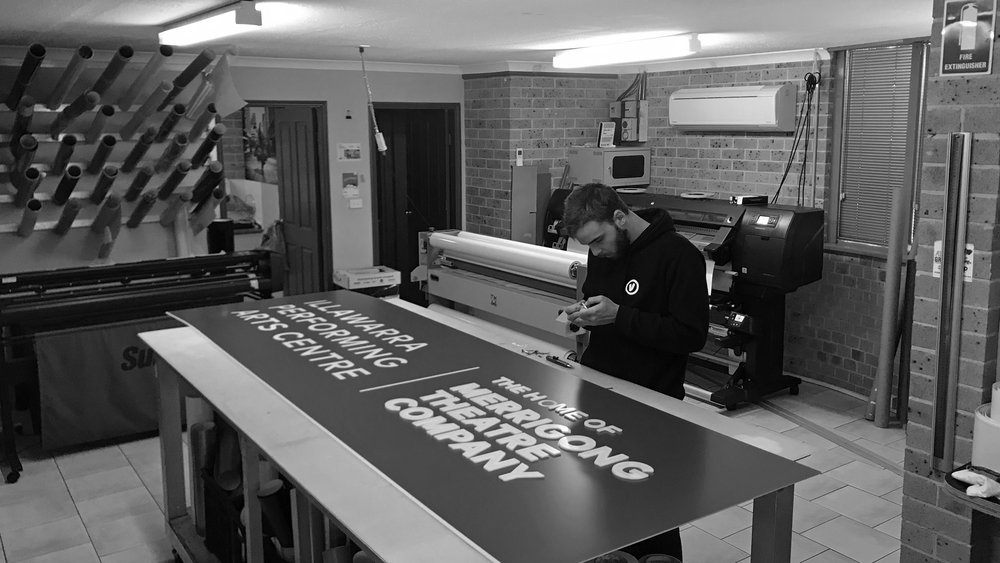 The application of profile cut letters in the graphics room.