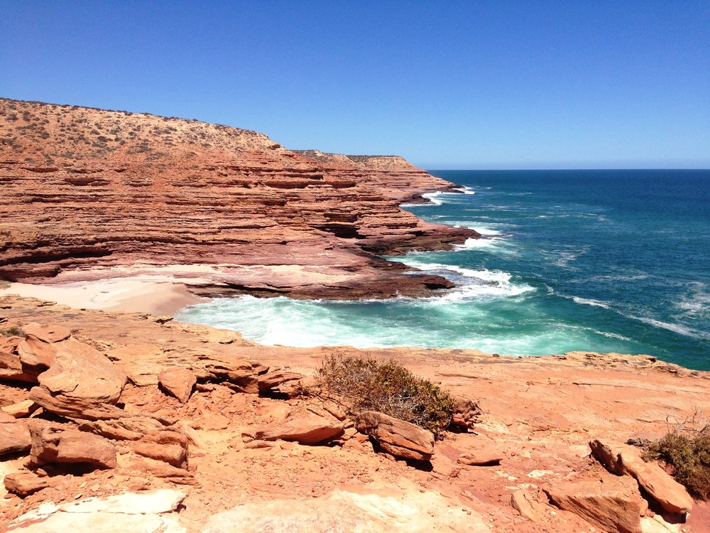 Red cliffs and deep blue water are a signature in Kalbarri