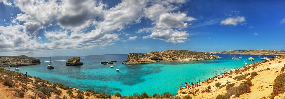 The Blue Lagoon on Comino Island is one of the most famous natural landscapes in all Malta - it's easy to see why!  Image: @mermaid_tales_adventure
