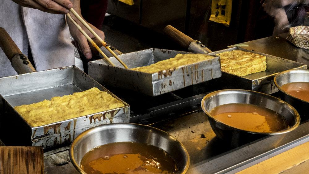 Flipping tamago at tsukiji fish market