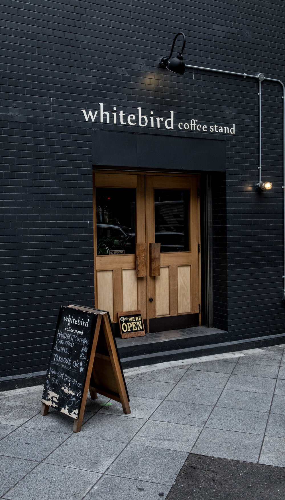 white bird coffee stand street view