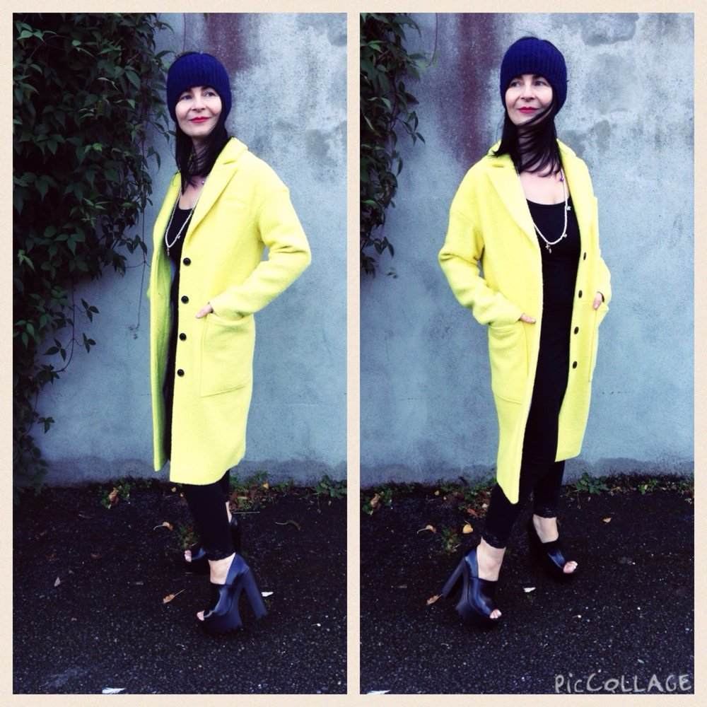 "Modern canary yellow coat worn over an"" All Black"" pallette is a winner every time. Coat is M&S."