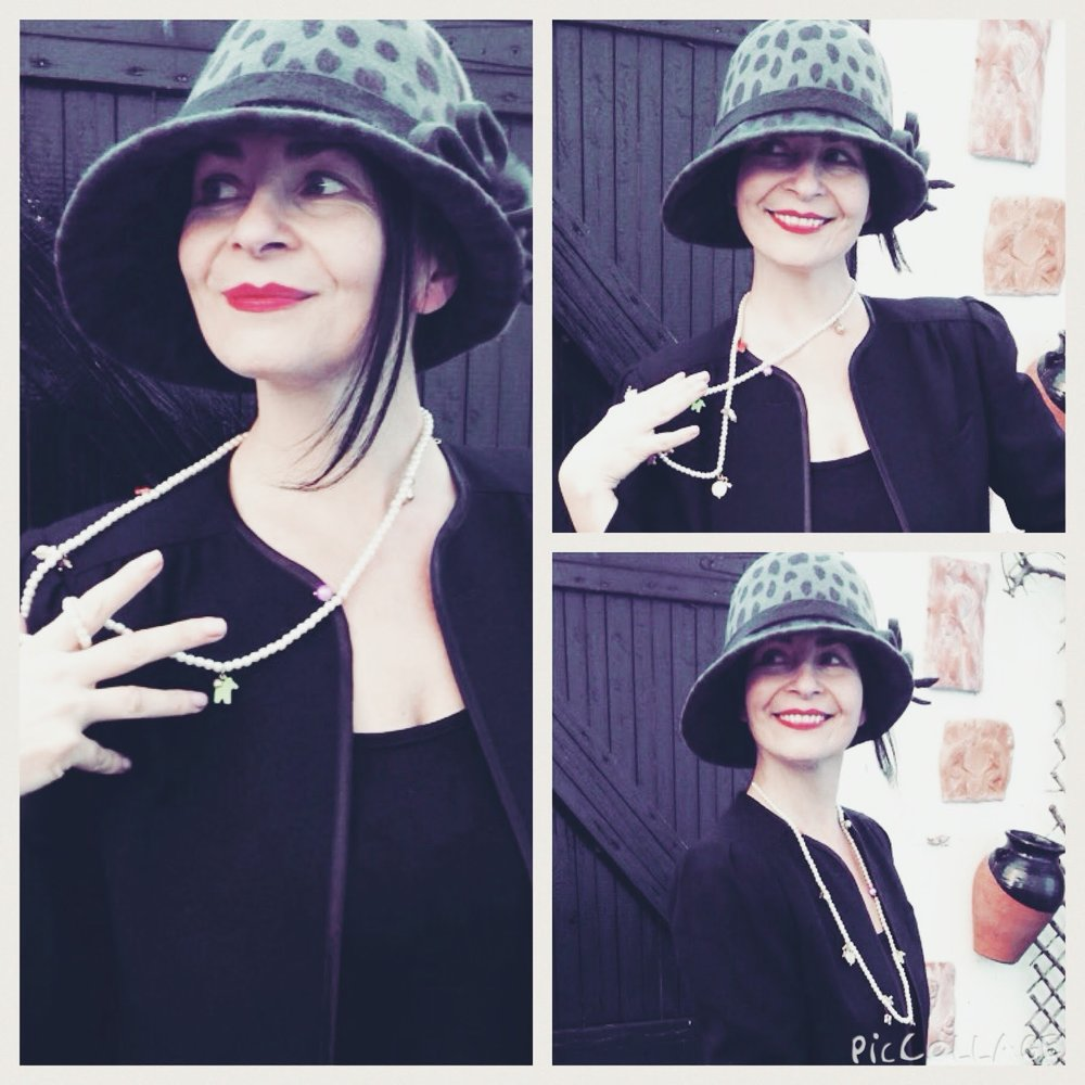 This hat a vintage designer gem is a style that crossed from late 1920's -1930's but is very similiar to the pure style of a 1920's clouche! Love it!