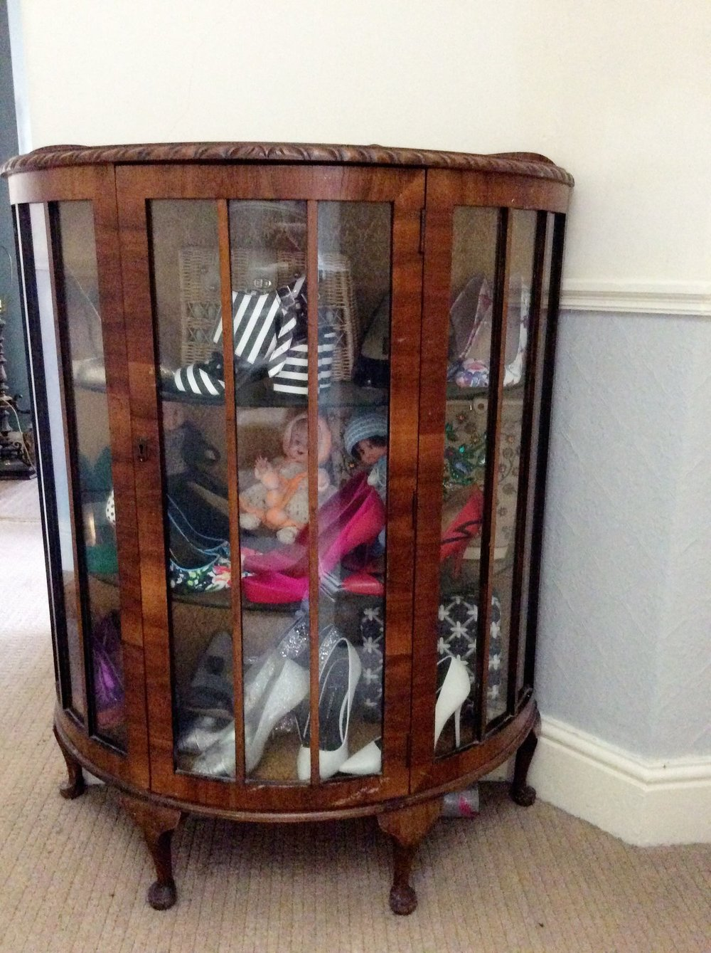 Originally a dark brown wood with an unflattering brocade lining.