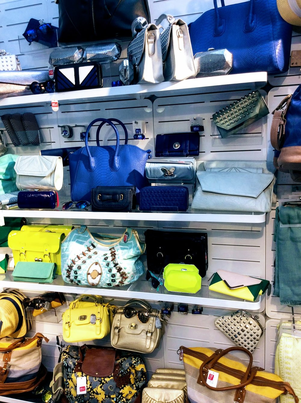 An array of jewel coloured bags from the tempting Oxfam accessory store SIX 4 GOOD.