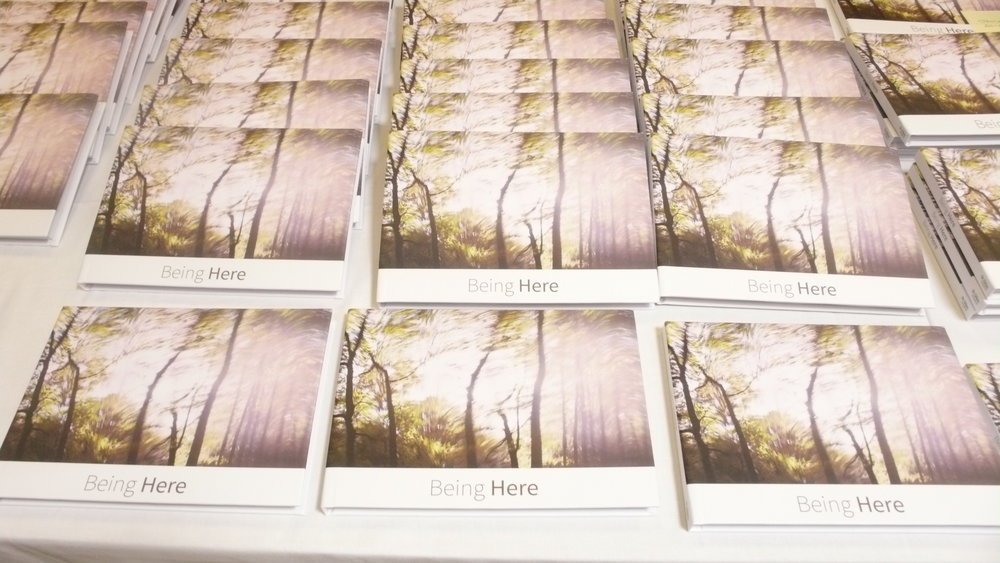 copies of the book 'Being Here'