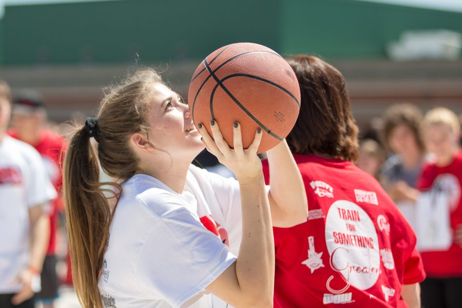 Alex's sister, Sophie Betzhold, takes a shot at the annual Shoot 4 The Stars basketball tournament.