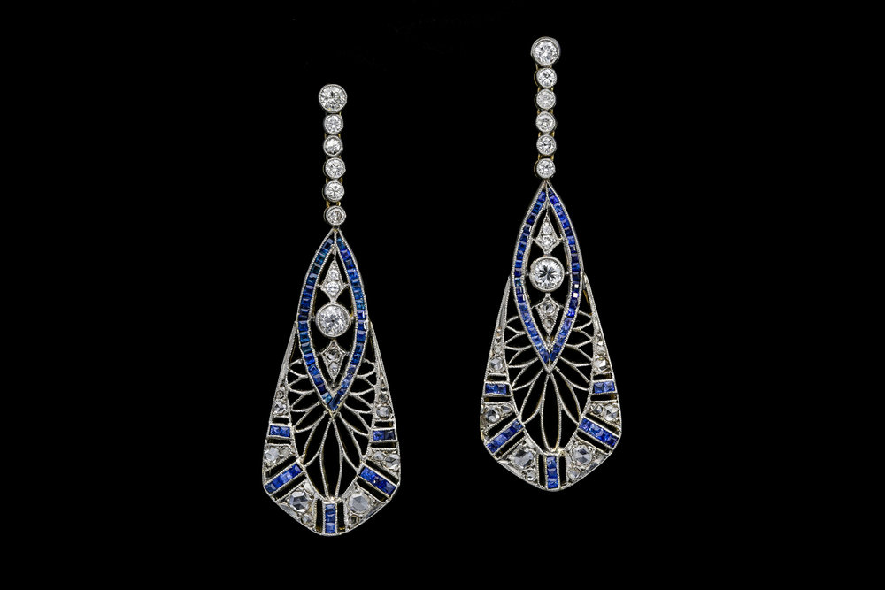 A pair of calibre cut sapphire and diamond pierced openwork Art Deco drop earrings set | £7240