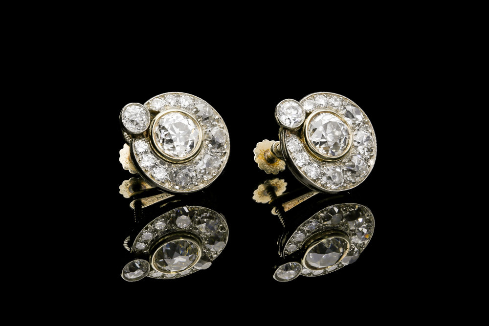 A pair of Art Deco diamond clip earrings set in platinum and gold   £16500