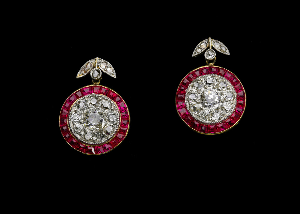 A peerless pair of early Art Deco calibre cut ruby and diamond cluster drop earrings set | £9850