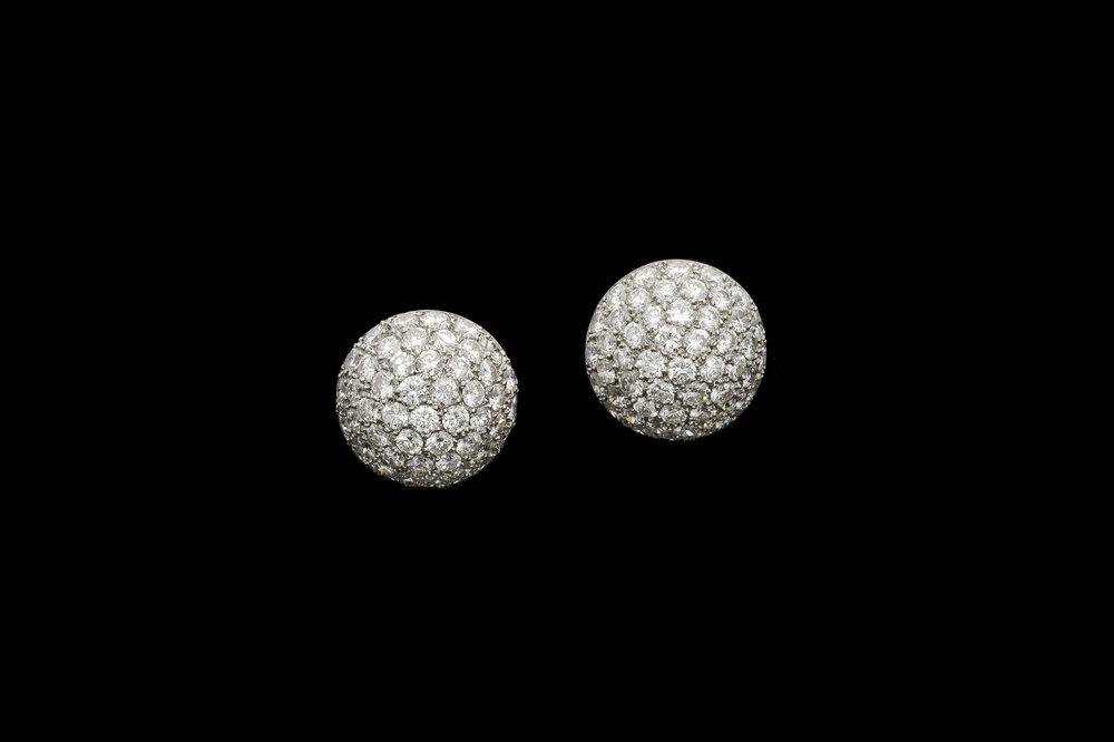 A phenomenal pair of 1950's bombe diamond stud earrings set   £10500