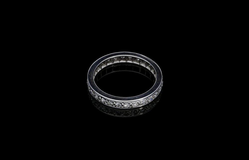 A 1950's French eight-cut diamond eternity ring set   £2200