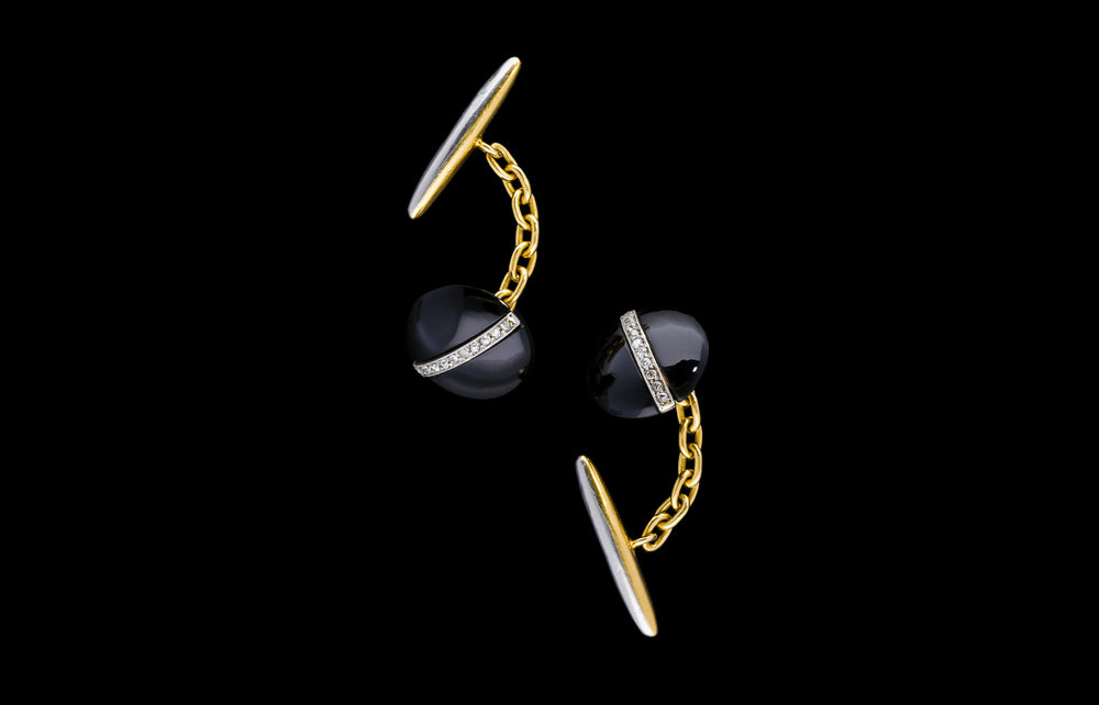 A onyx and diamond Art Deco cufflinks | £2450