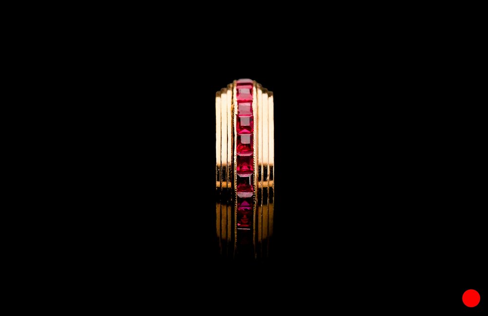 A 1950's calibre cut ruby eternity ring   £2500