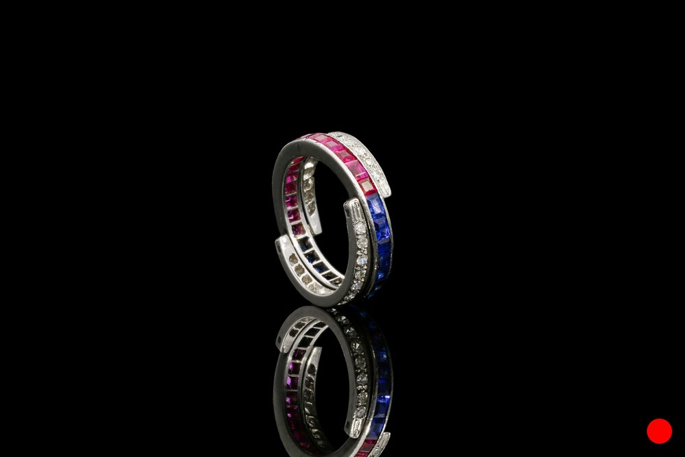 A 1940's hinged sapphire,eternity ring   £3700