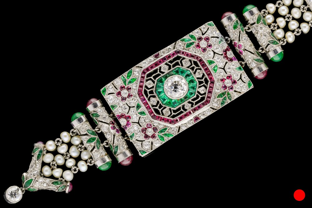 An exceptional Art Deco diamond, ruby, emerald and seed pearl necklace set | £9900