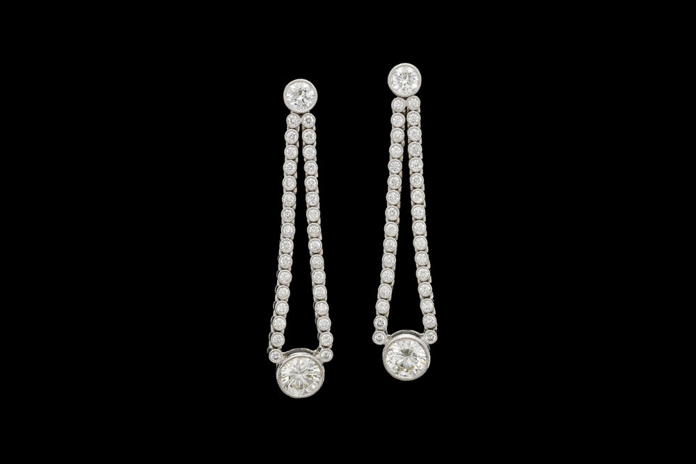 A stylish pair of 1950's transitional round brilliant cut diamond drop earrings set | £19950