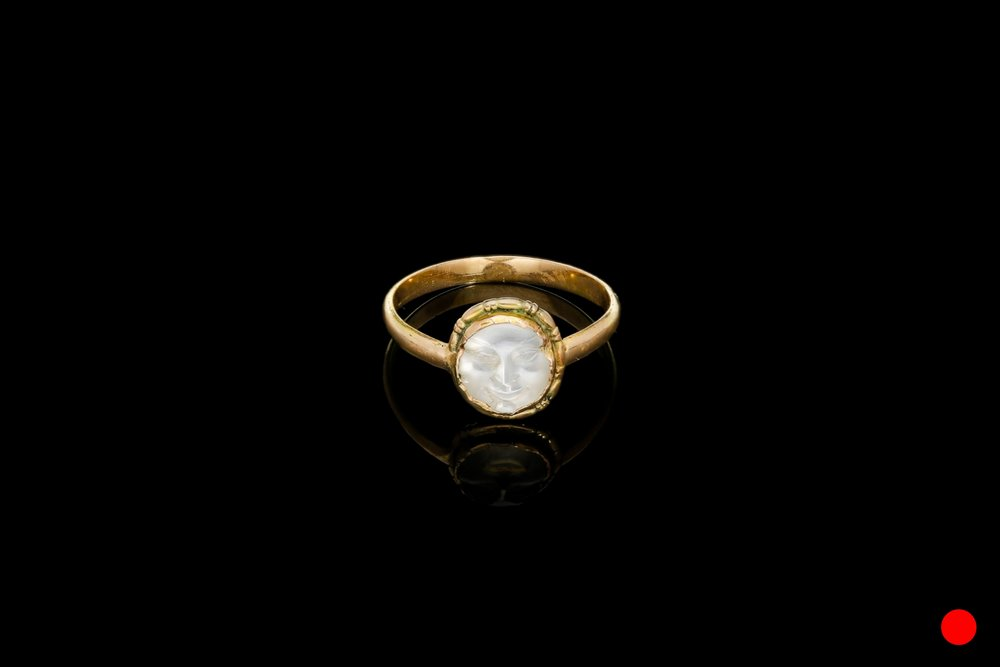An exquisitely carved Victorian man in the moon moonstone ring set   £1150