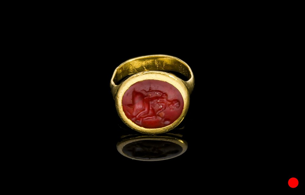 A 1st to 2nd century AD Roman hand engraved carnelian seal ring   £4200