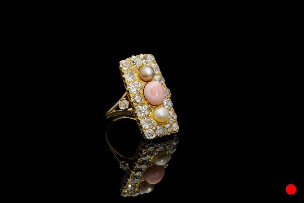 A Victorian conch pearl,cluster shield ring   £4750