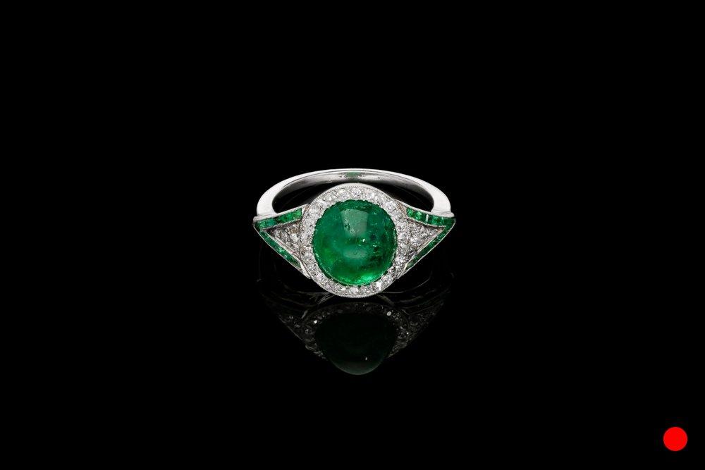 An Art Deco cabochon ring set   £9900
