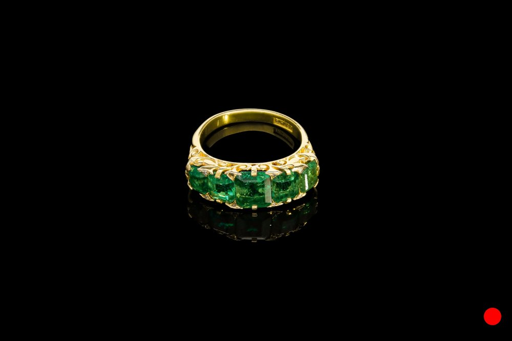 A Victorian five stone carved ring   £19250