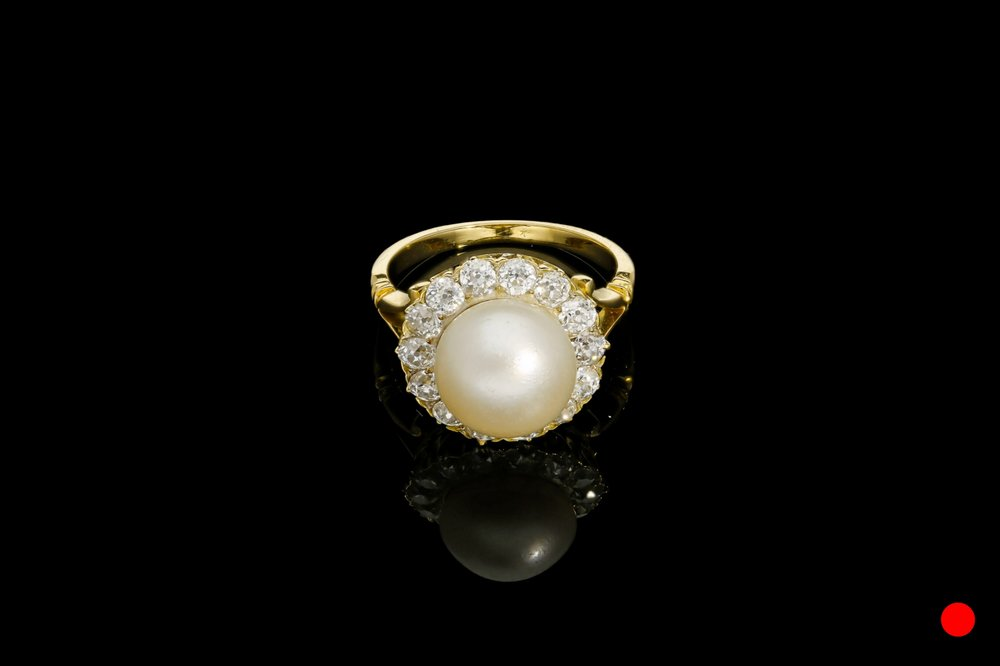 A natural buton pearl and diamond cluster ring   £6850