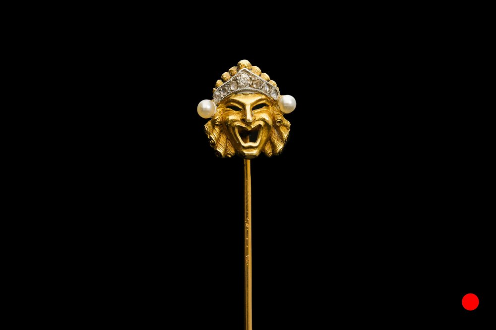 A Edwardian Greek comedy mask pin | £1650