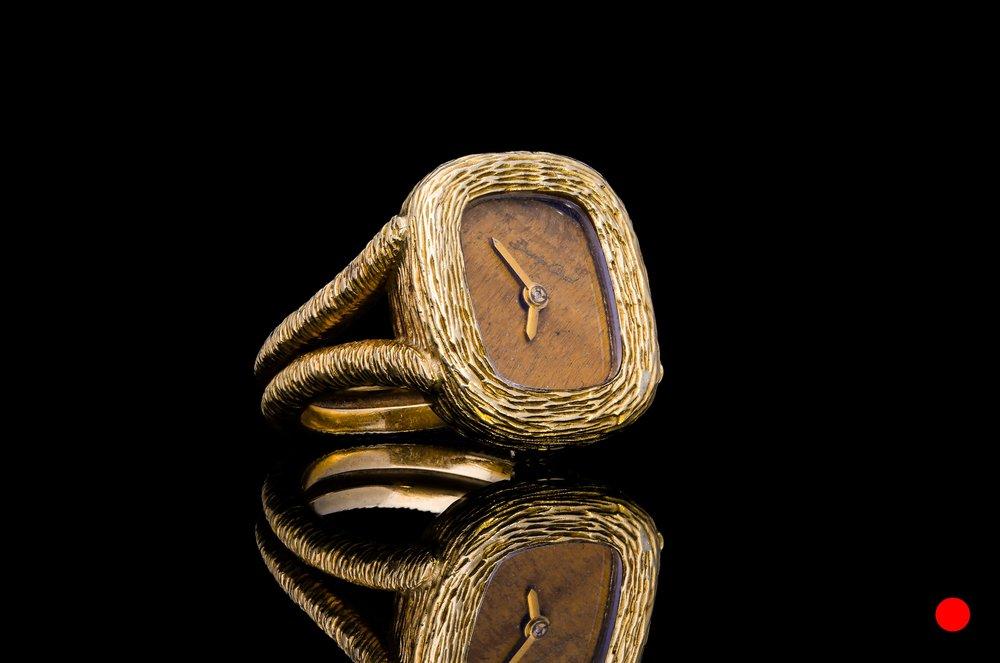An 18ct gold ring watch by Bueche-Girod   £3200