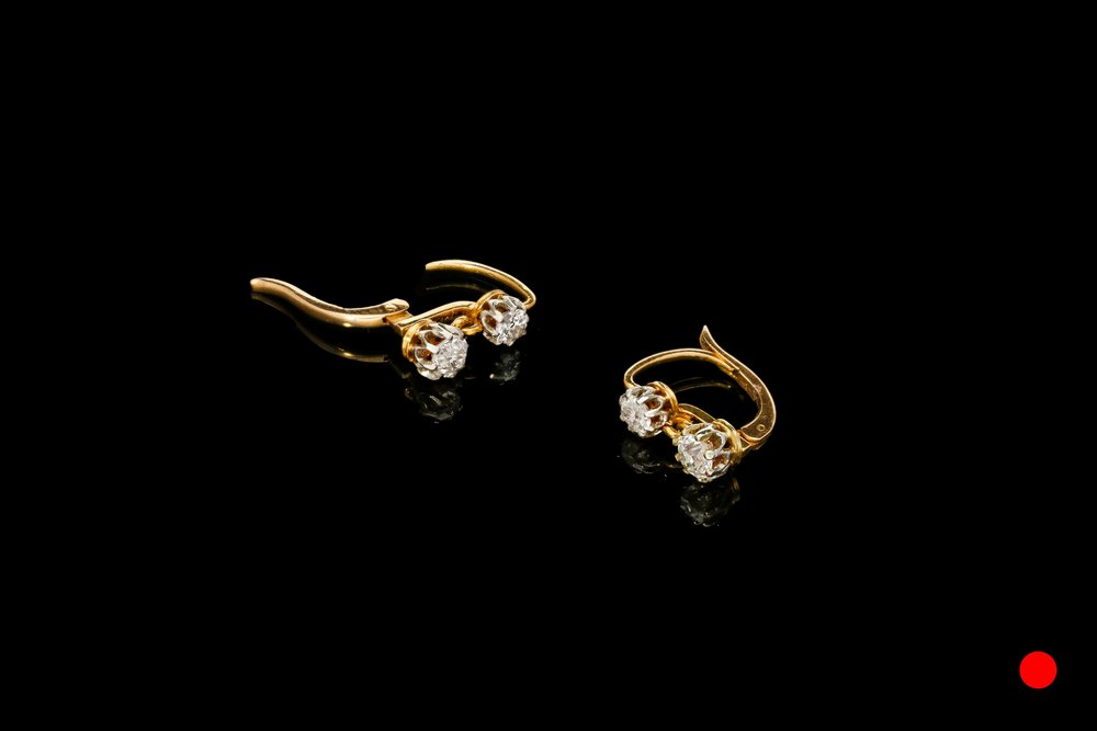 A pair of Edwardian articulating diamond earrings set in platinum and gold   £1275