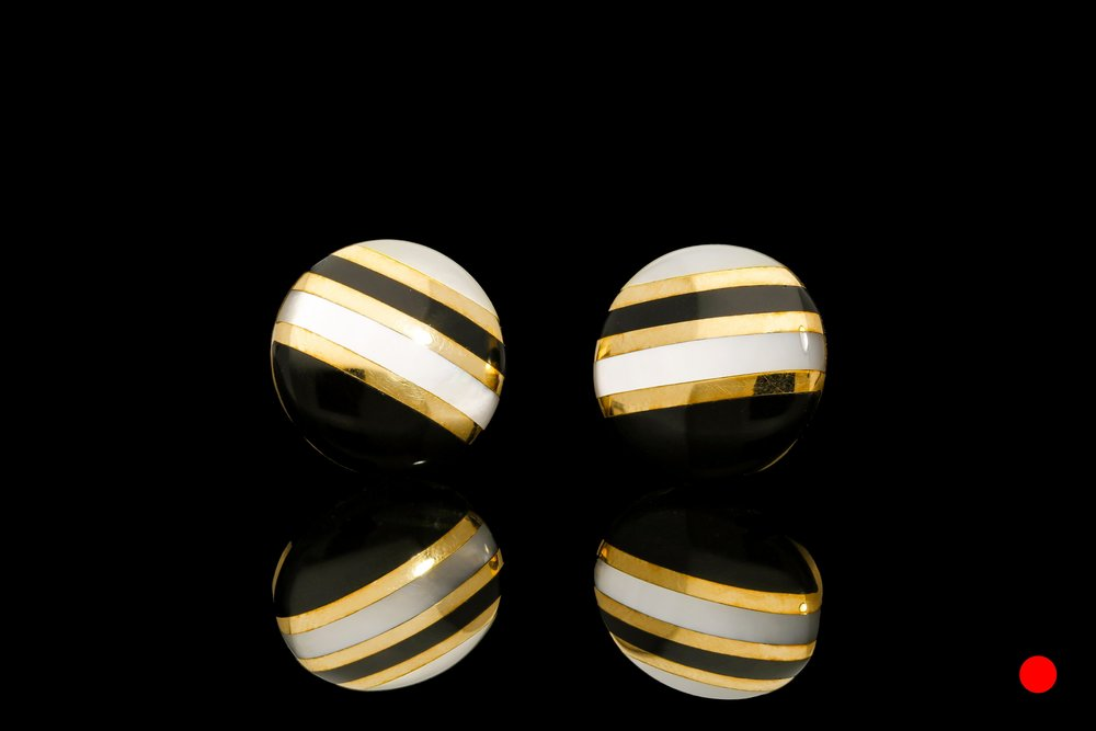 A pair of 1950's 14ct yellow gold onyx and mother of pearl inlayed domed earrings   £1800